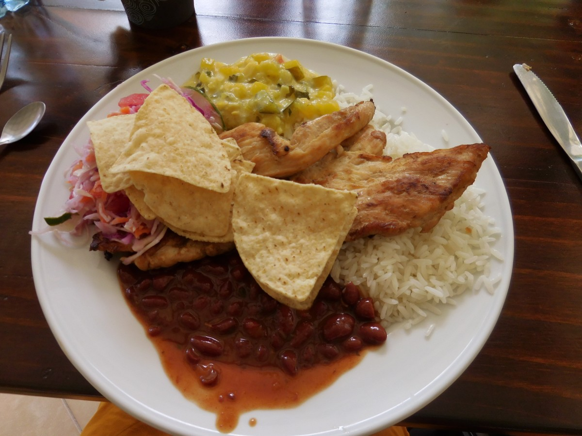 Casado served with your choice of chicken or tilapia. Absolutely delicious!