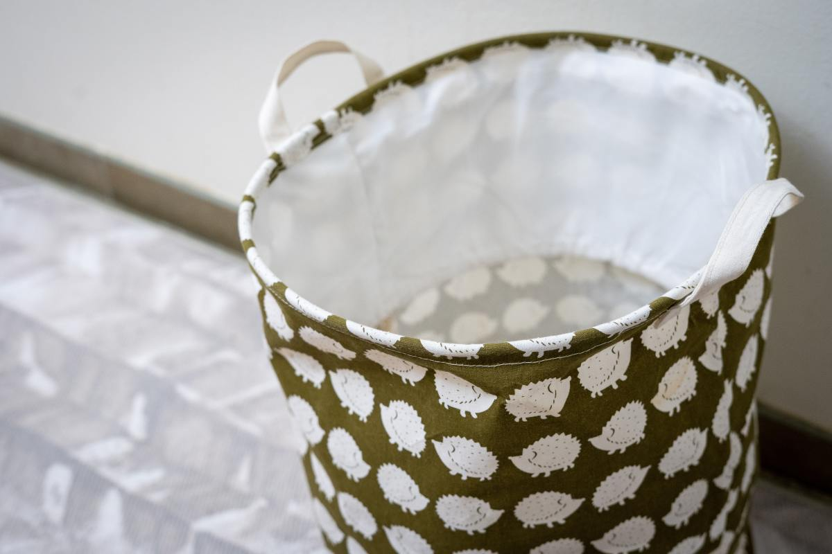 Remember that hampers and baskets made of fabric can also trap the odor of the clothes you throw in them.