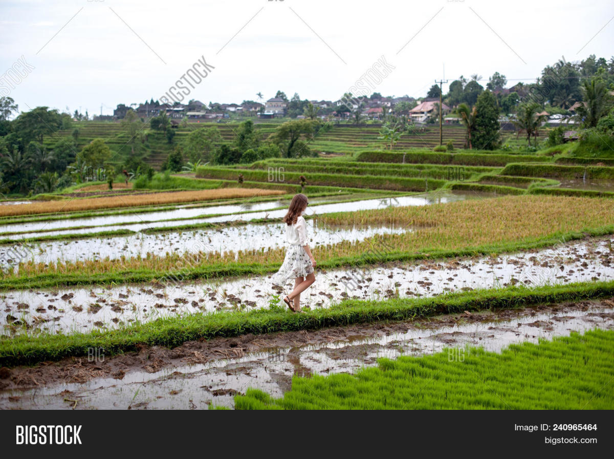A woman walking through field