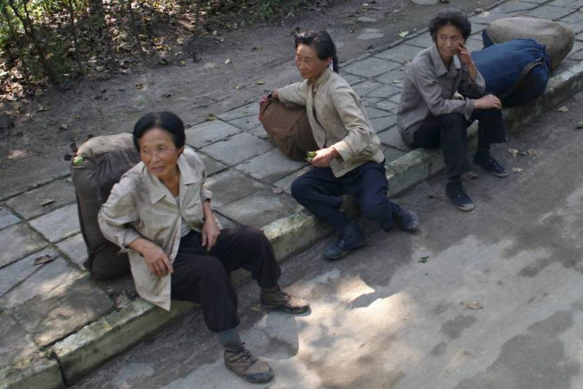 These North Korean women are risking their lives by running an market selling illegal goods. People in rural communities rely on these illegal markets to survive