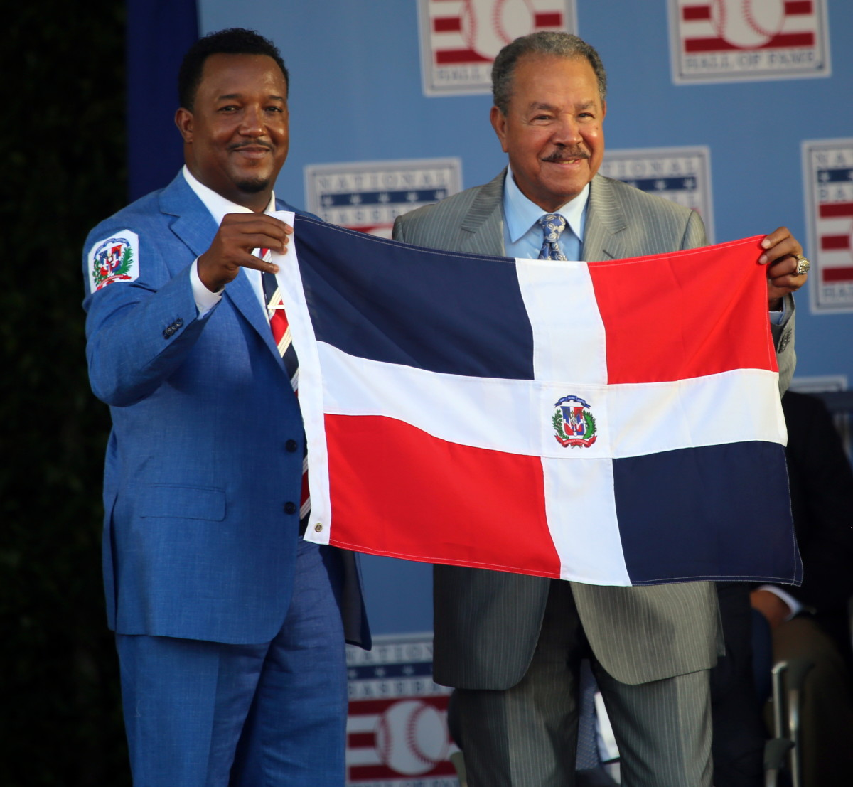 Pedro Martinez (left) and Juan Marichal hold the flag of the Dominican Republic after Martinez became the second native of the island to be inducted to the Hall of Fame. Marichal and Martinez were joined by Vladimir Guerrero in 2018.