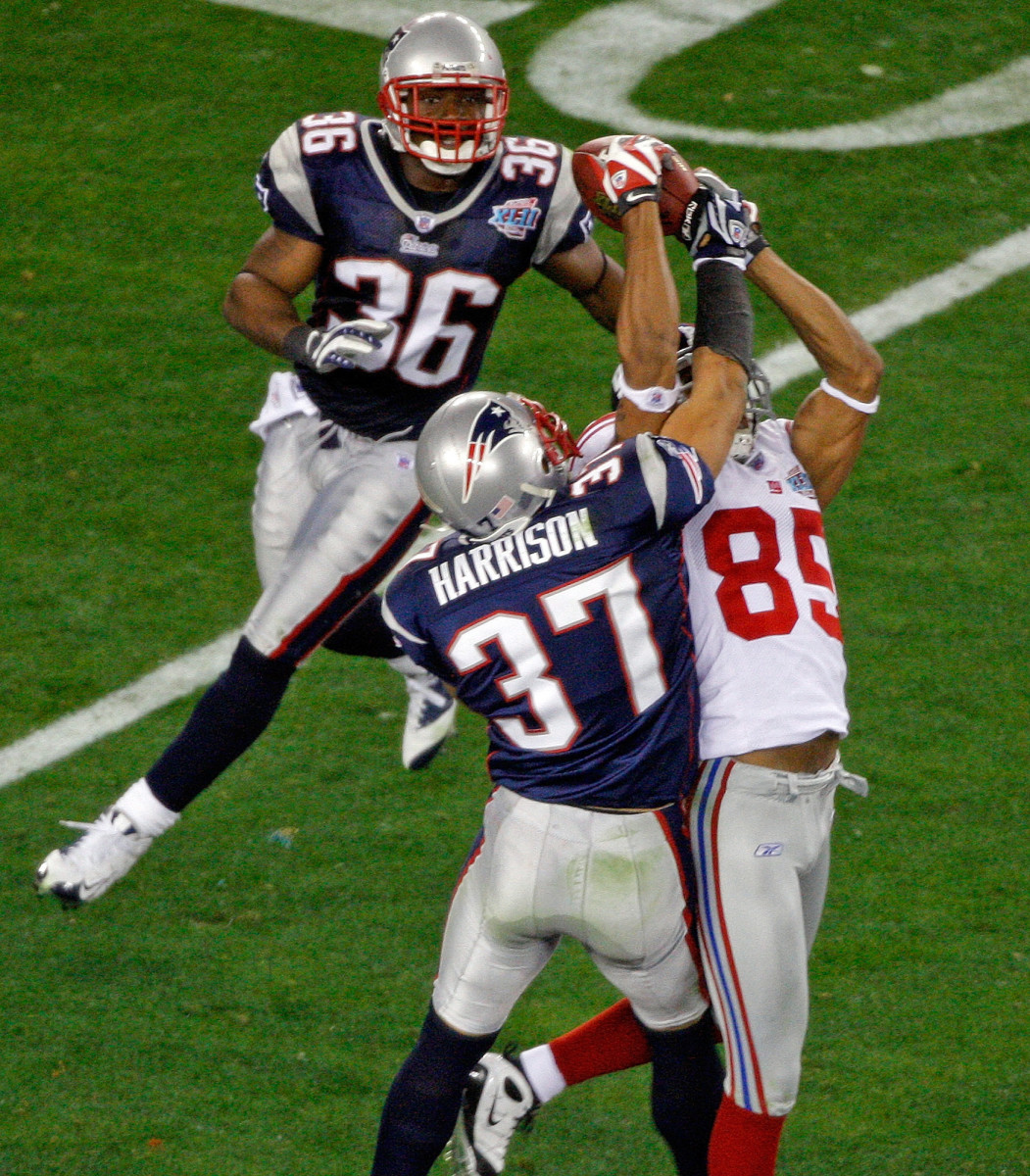 David Tyree catches the football with his helmet in one of the most clutch plays in Super Bowl history.