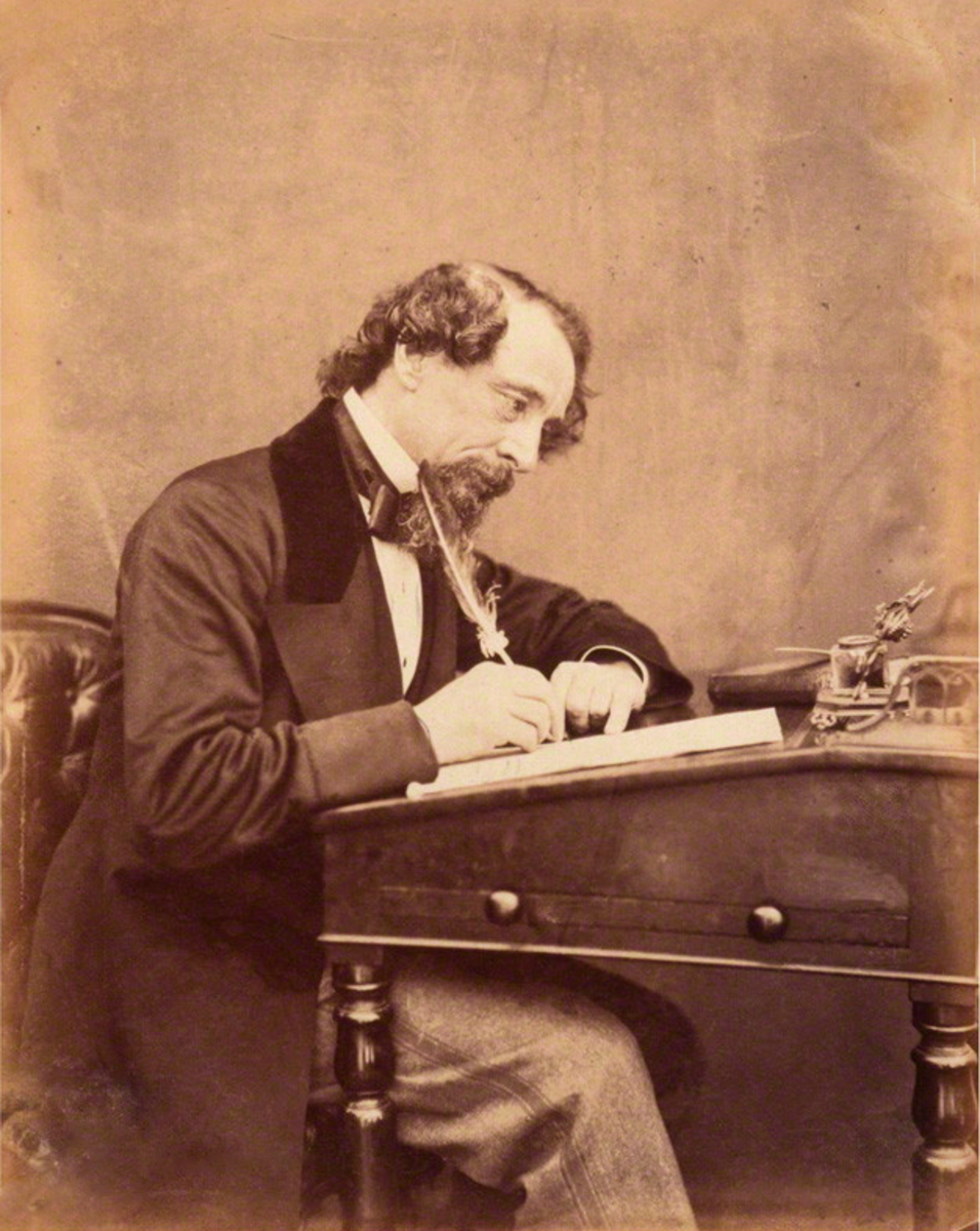 Dickens at his desk.  1858