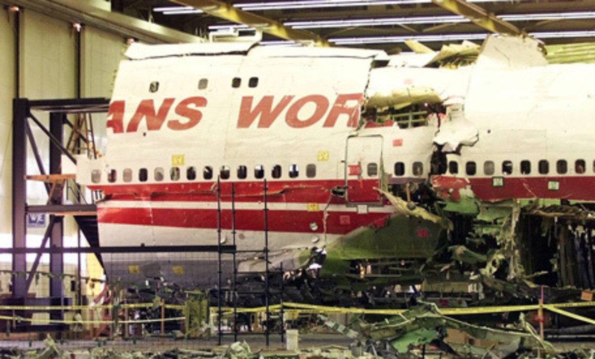The wreckage of TWA Flight 800 sits in a hangar in Calverton, N.Y