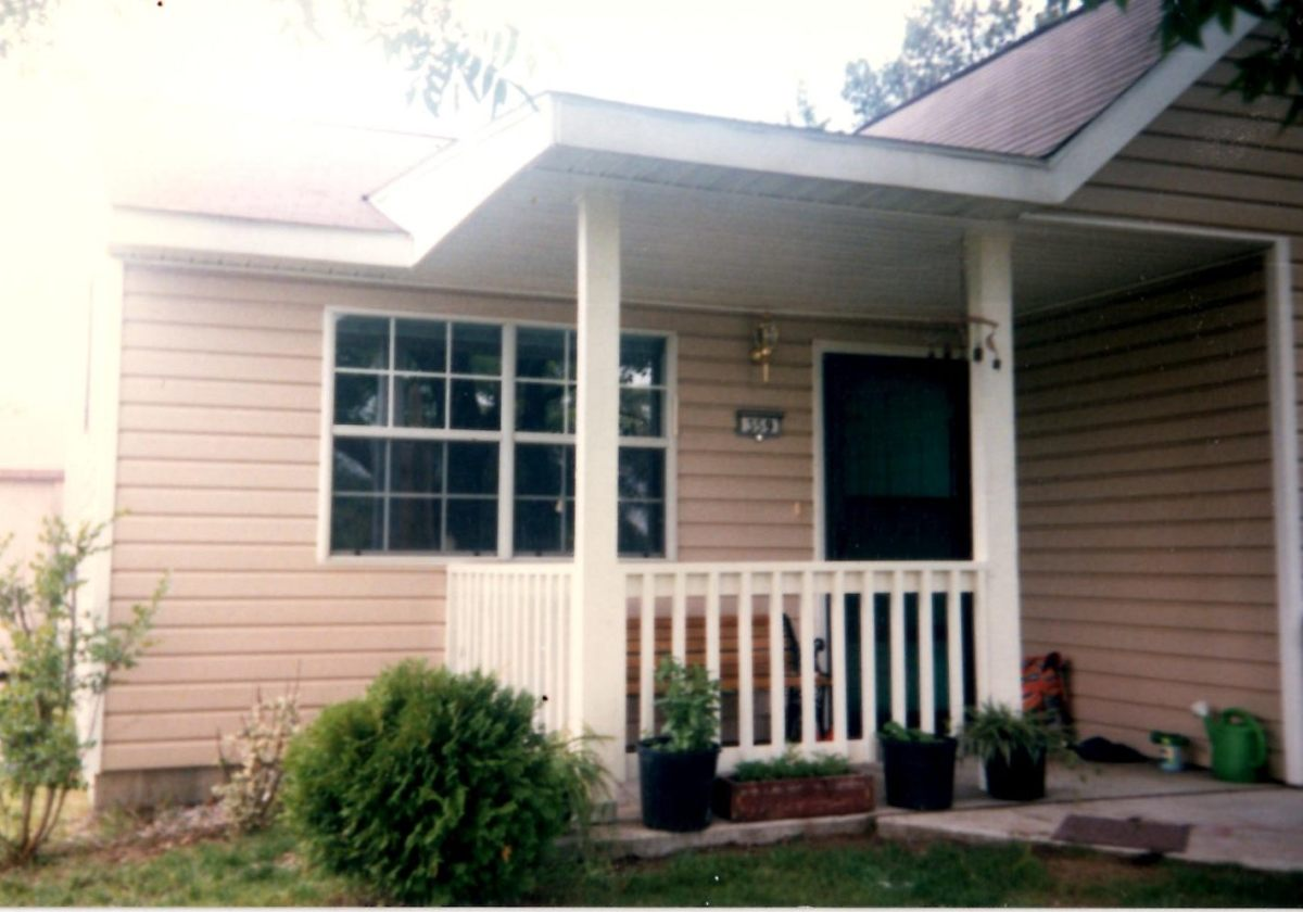 Added a porch the year after moving in. Overhang, posts, and railing.