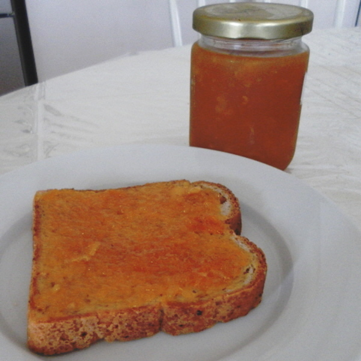 Spread homemade navel orange jam on a slice of toast. It is simply delicious!