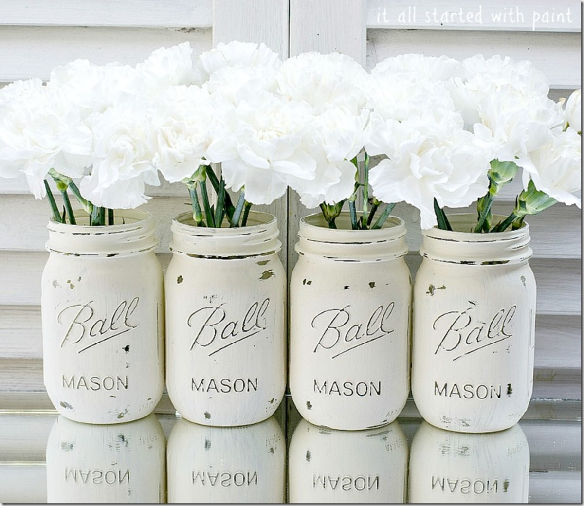 These were painted mason jars in Annie Sloan Chalk Paint in very pretty white.