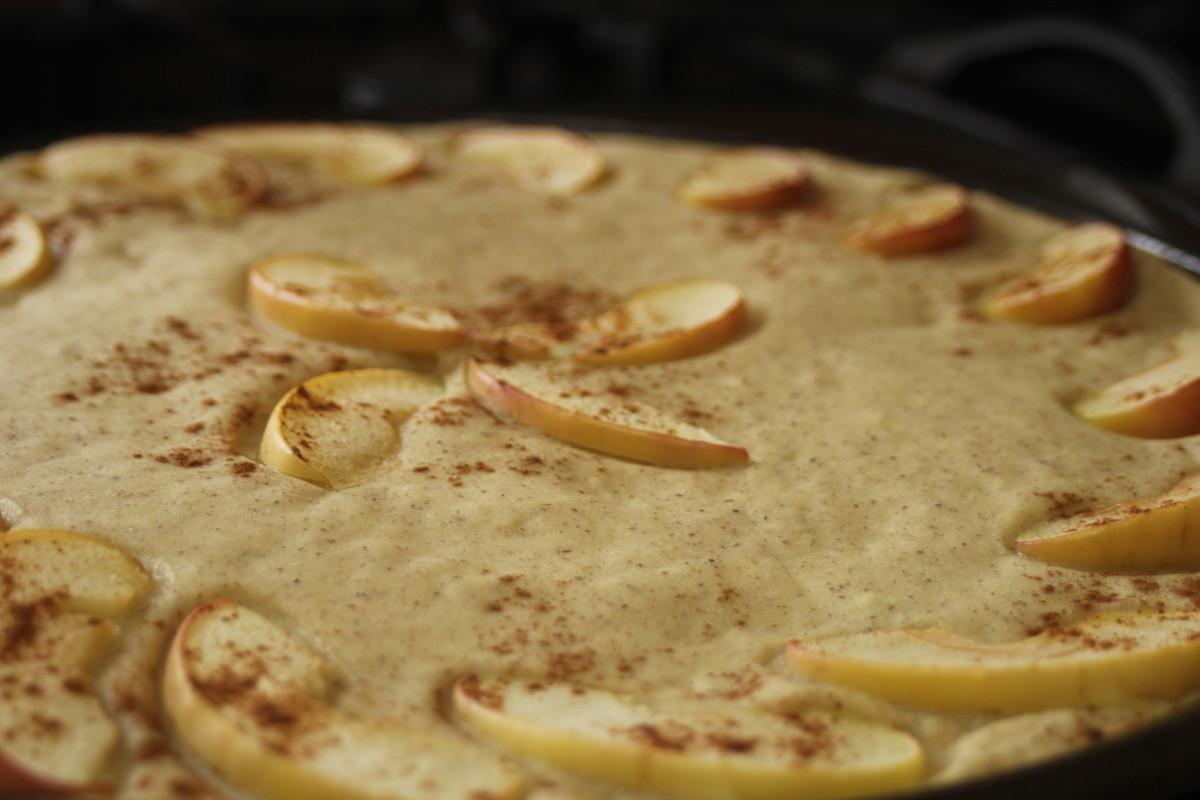 Vegan, oven-baked, fluffy pancake with apple, cinnamon topping