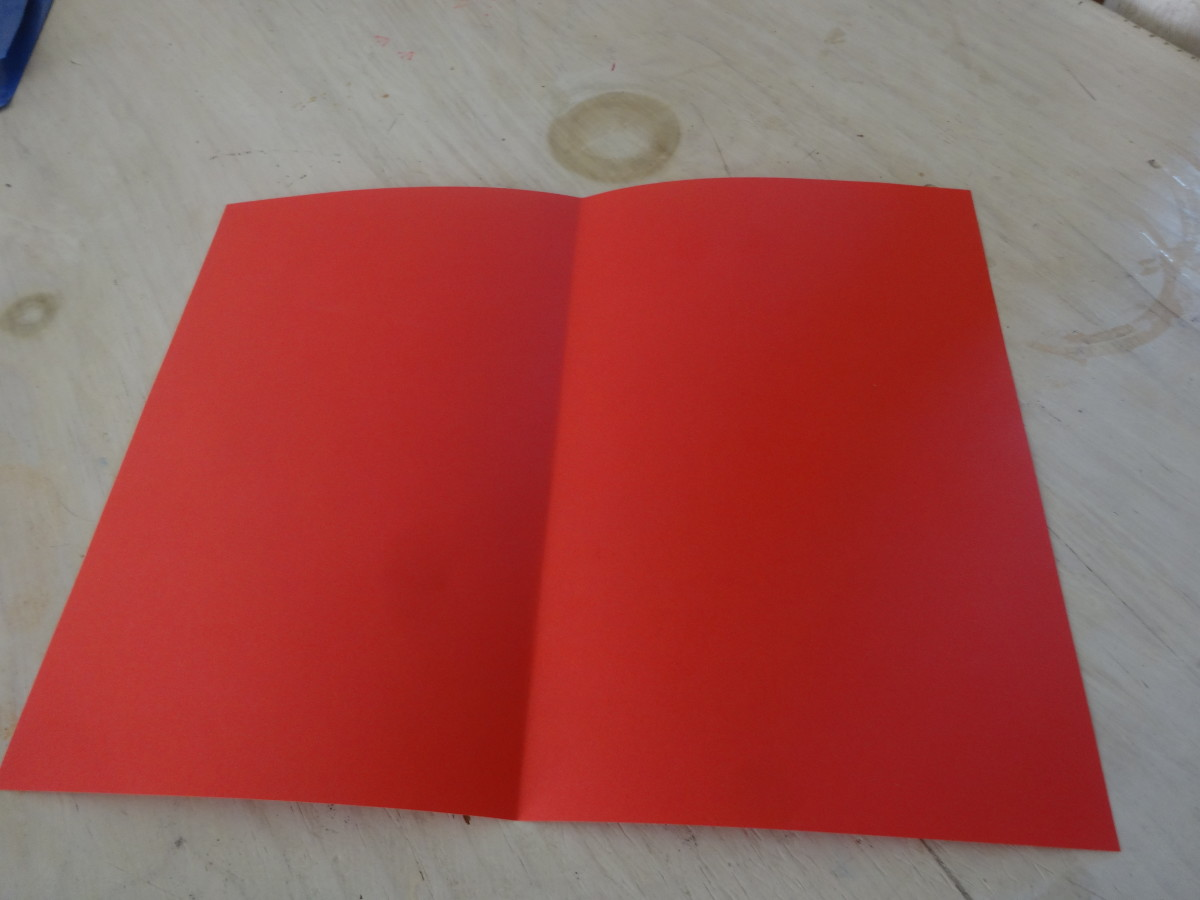 Take a piece of colored paper (or card stock) and fold it in half.