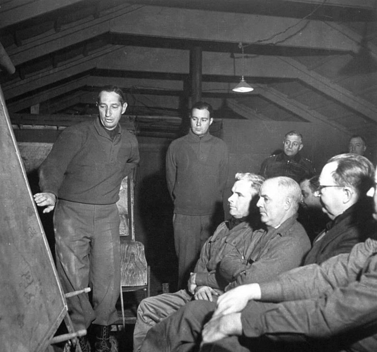 Clark speaks with reporters. General Truscott is in the back (leather jacket). Even Clark's relationship with the press corps became strained.