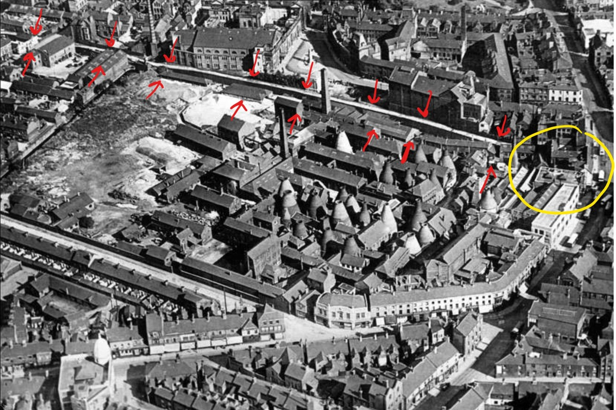 An aerial photograph of Stoke from 1927 showing the Spode factory and the Newcastle-under-Lyme Canal (the red arrows). The yellow circle shows where the tunnel goes underneath the road at Church Street, Campbell Place.