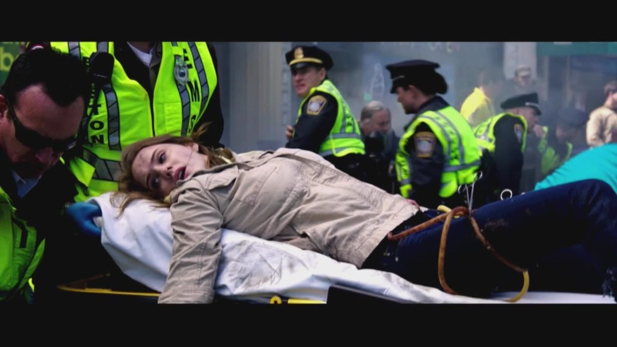 Injured Jessica Kensky escorted out of the marathon in a stretcher