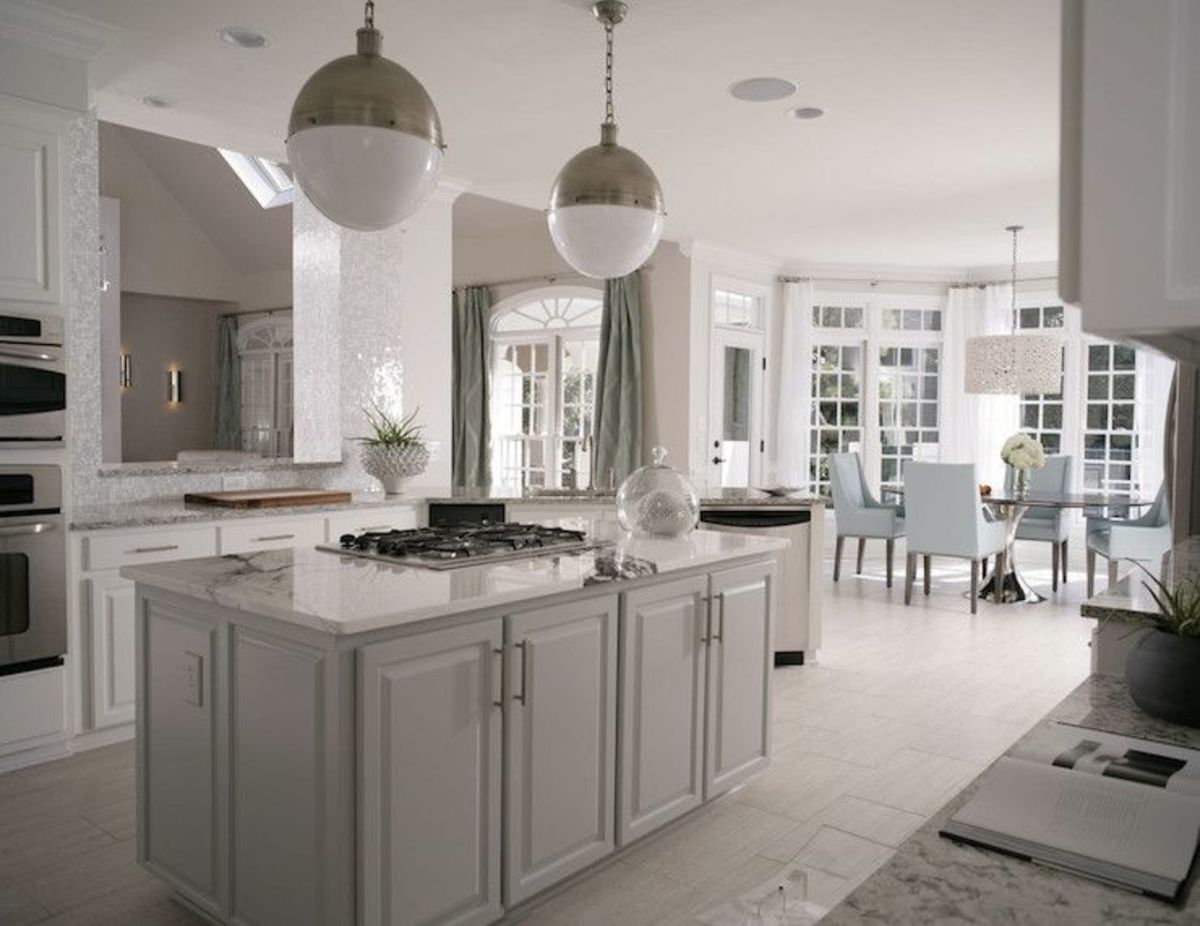 A metal feng shui kitchen should have no wood displayed. Objects should be round, metallic, creative, surreal, and glimmering.