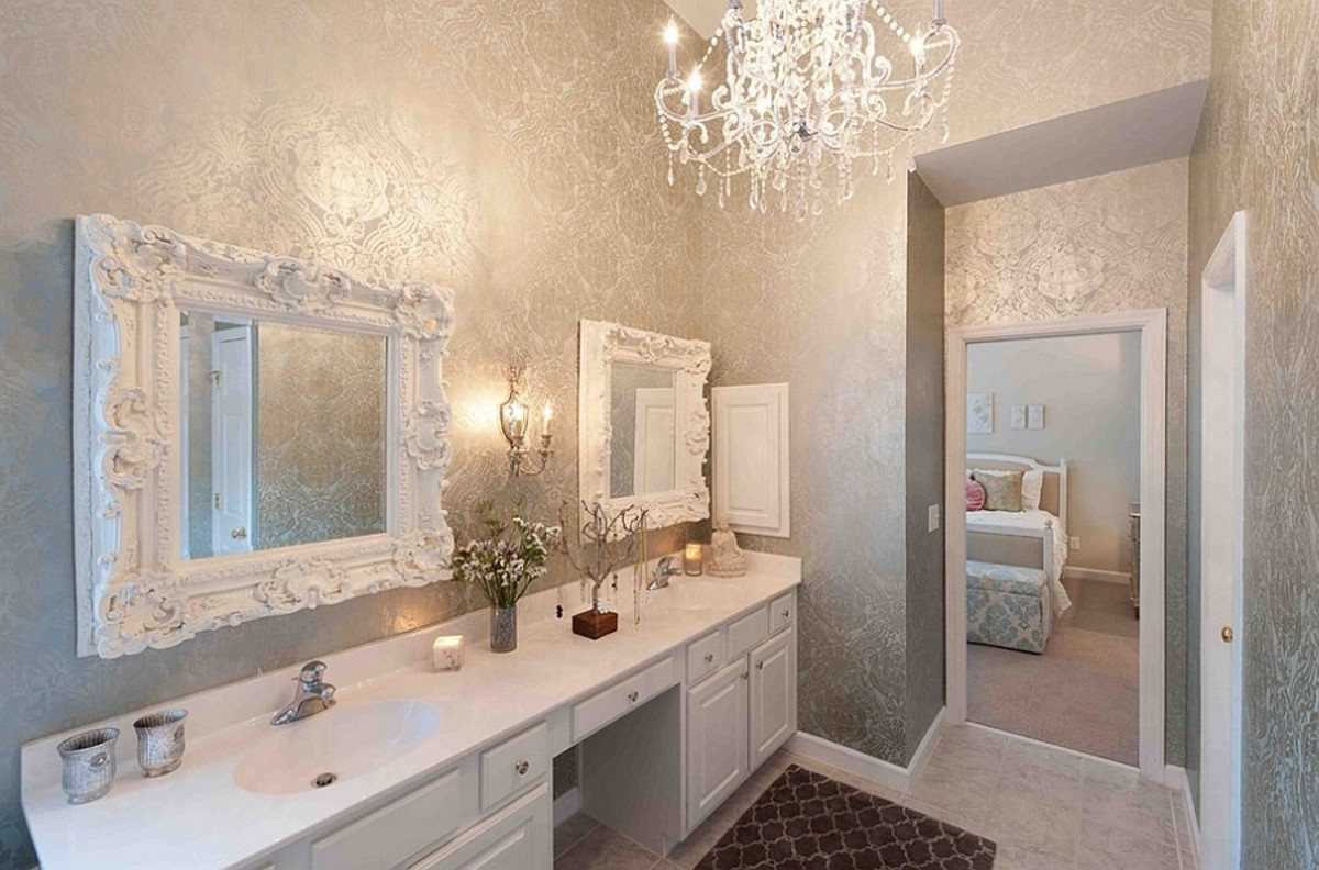 A bathroom with metal feng shui should have extra mirrors, a chandelier, tile flooring, touches of gold and silver.