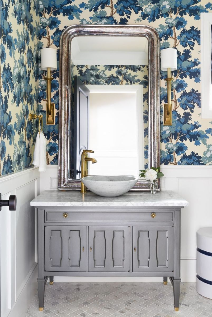 The powder room is metallic, bold floral and blue color.