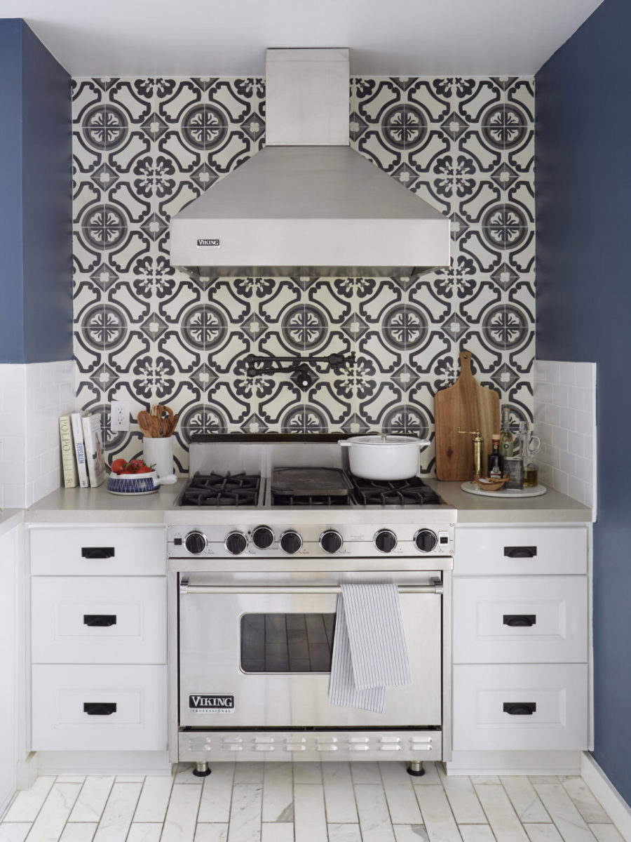 The kitchen tile wall it is white & black, blue paint and gray floor tiles.