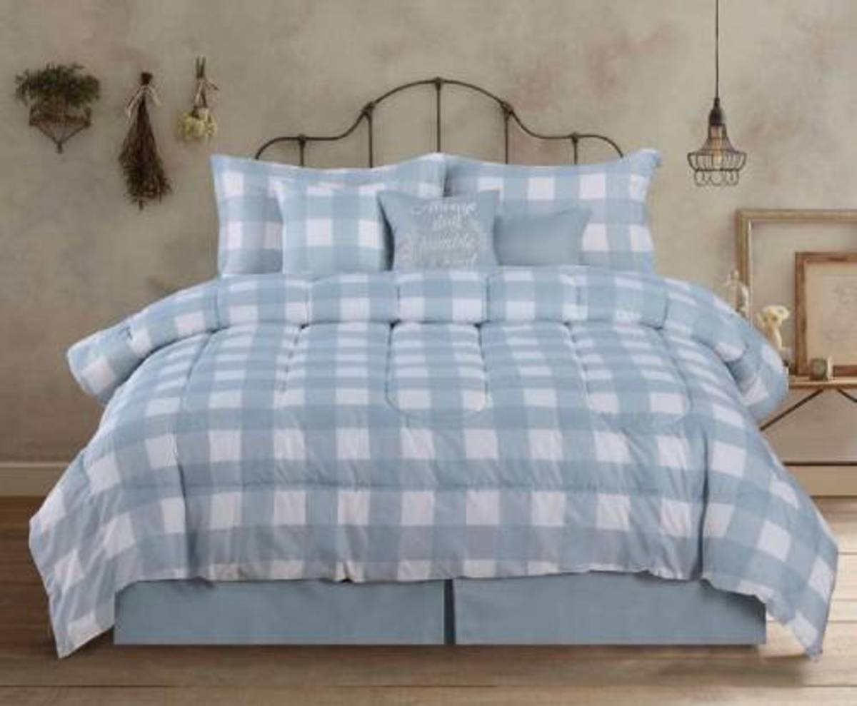 Farmhouse is in the  country bedroom with the buffalo check soft blue-gray and the pretty toss pillows. .