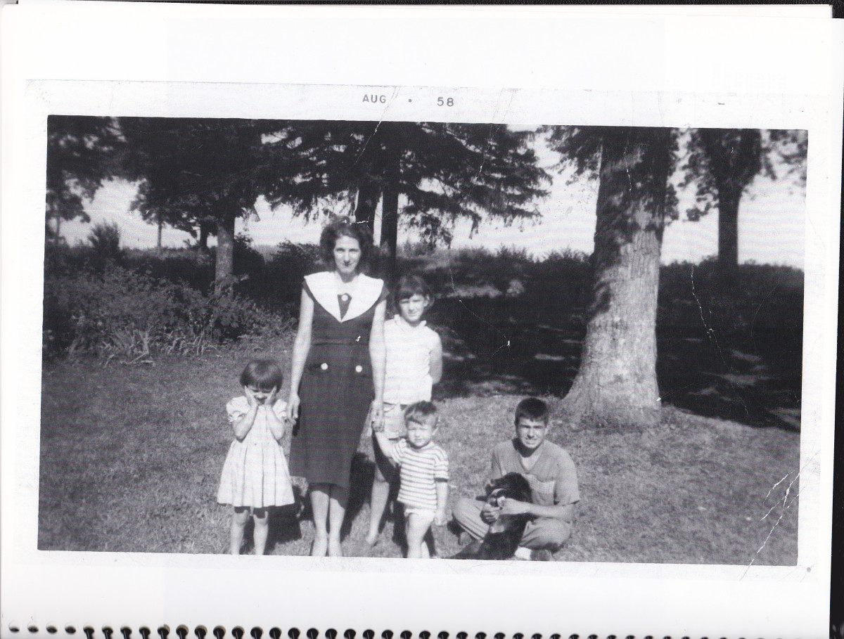 Author with mother, two sisters, and brother on front lawn of farmhouse.  Taken in August 1958.
