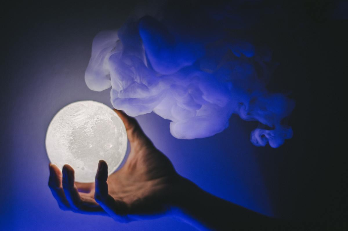 Do a Full Moon divination. Photo by okeykat on Unsplash