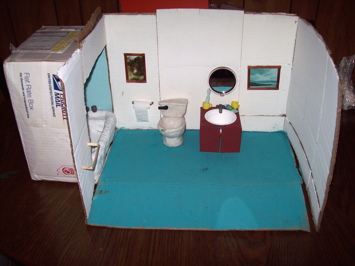 Bathroom Stop-motion set - Includes bathtub, toilet, sink, mirror, pictures, props (tooth brushes, bubble bath, cups, etc.) one box wall that pulls back for easier access for camera.