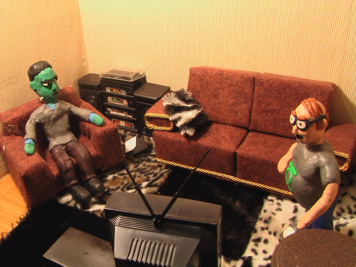 Living Room Stop-motion Set - Close up with Frankenstein and a comic book guy. Features couch, fur rug, TV, chair, stereo, table, etc.