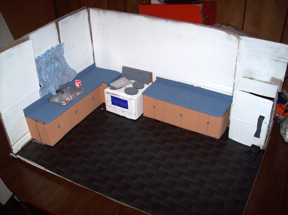 Kitchen Stop-motion Set - Includes stove, counters, sink (made of a yogurt container and painted silver), curtain (made of an old cloth), fridge. Side wall removed for easier camera shots. Although not seen back of fridge is removed for inside shots.