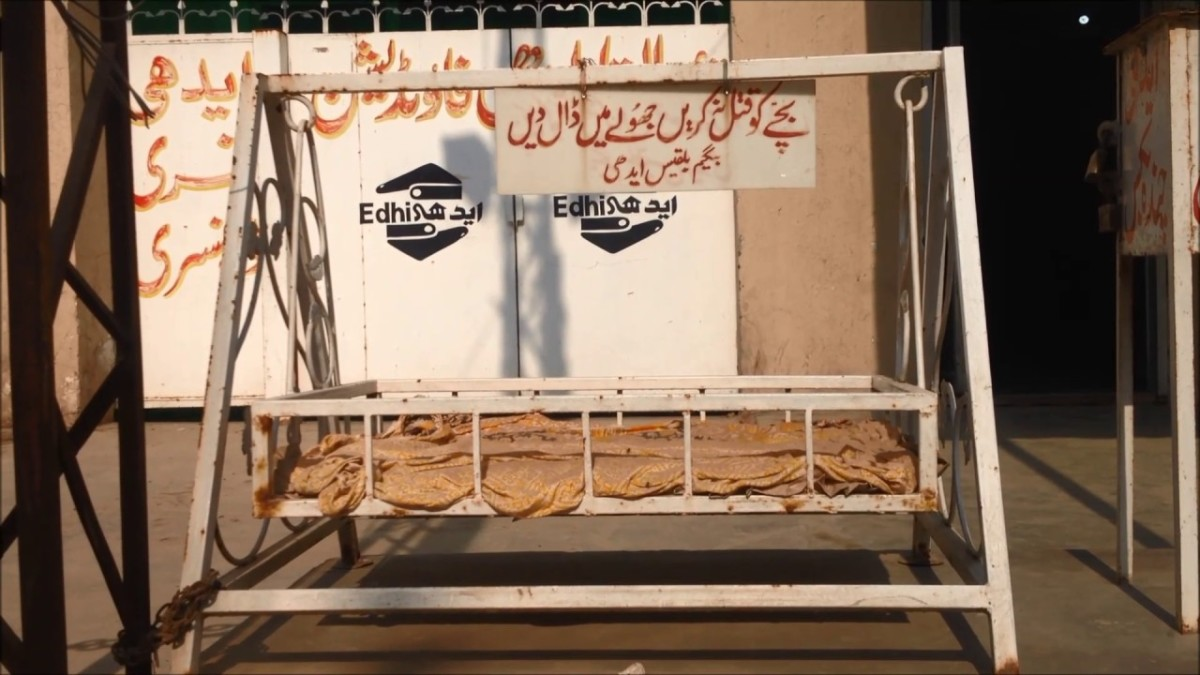 """Edhi Cradle, placed before all Edhi Centers, saying, """"Do'nt Kill your abandon child, place in cradle"""""""