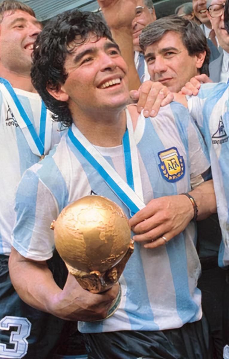 Diego Maradona celebrating the world cup win with Argentina.