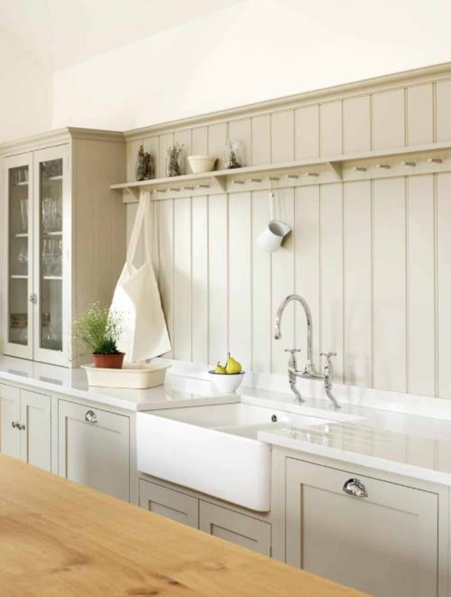 The kitchen is along the wall baseboard above the sink and the countertop.