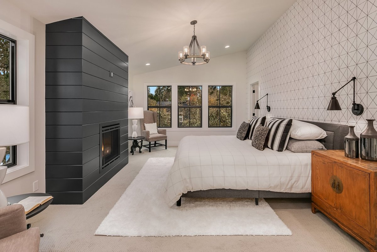 The fabulous black shiplap fireplace in the bedroom.