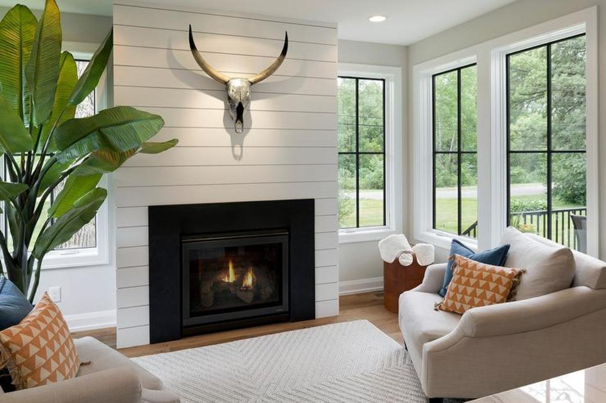 The unique white shiplap fireplace.