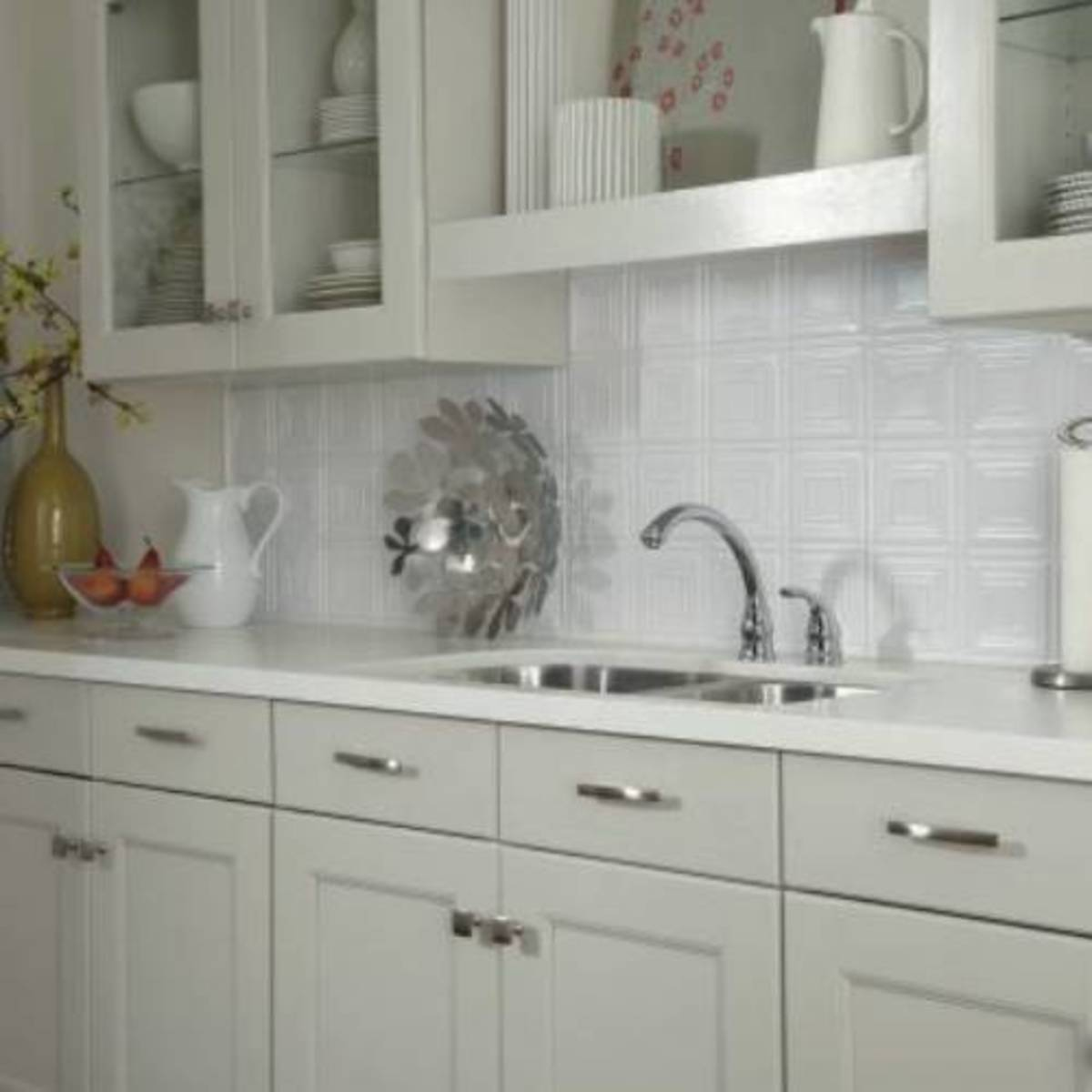 White backsplash tins are vintage styles on below the cabinets. The pressed tins are white backdrops.