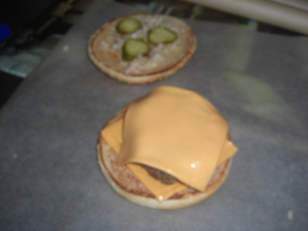 Place a further cheese slice on top of the burgers