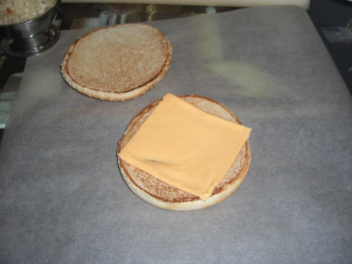 Place bun halves on your sheets of greaseproof paper, then place one slice of cheese on the bottom half of each bun