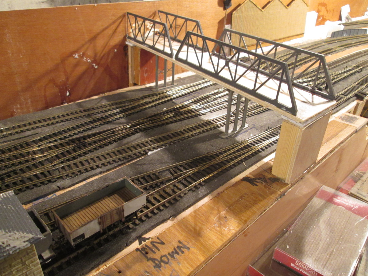Preliminary view of the slightly skewed bridge with girders tacked temporarily in place to show approximately how it'll look. The far girders have been cut short and will be depicted foreshortened on the backscene.
