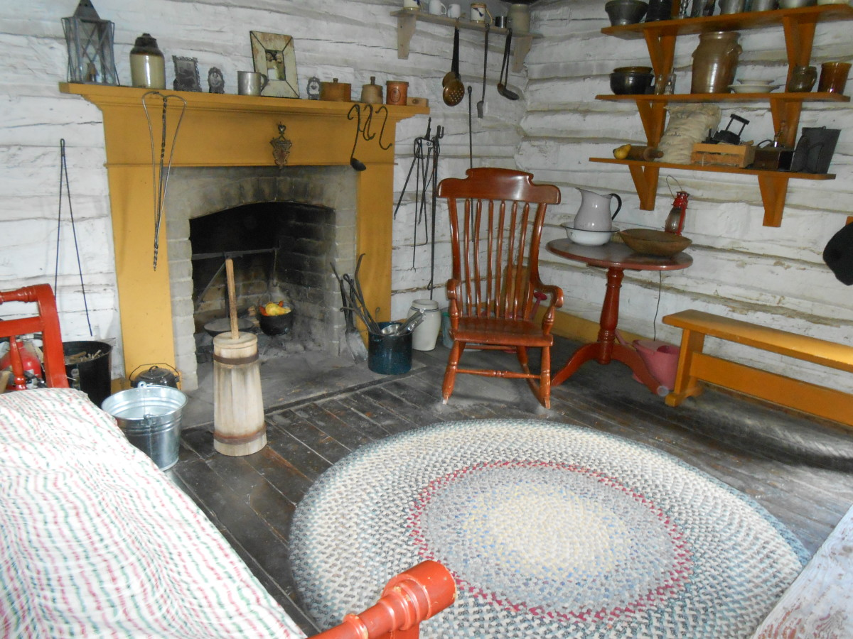 The fireplace in the John Gardiner cabin. The three girls in the family slept in front of this fireplace where the rug is.