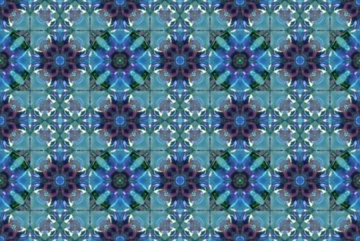 Tiny flower petals adorn this seamless tile for someone who likes plums and blues together.