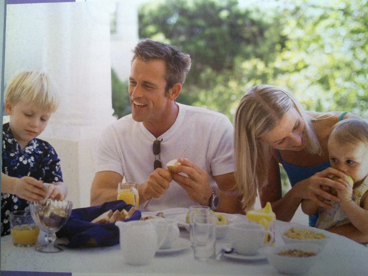A family happily eating together