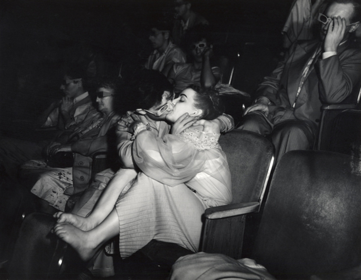 "WEEGEE ""LOVERS WITH 3-D GLASSES AT THE PALACE THEATRE 1943"" (SHOT WITH INFRA-RED CAMERA)"