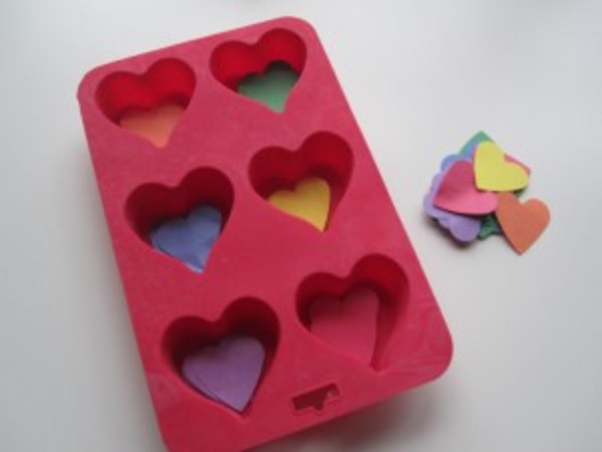 http://www.notimeforflashcards.com/2012/02/paper-hearts-crafts-activities.html - no longer active