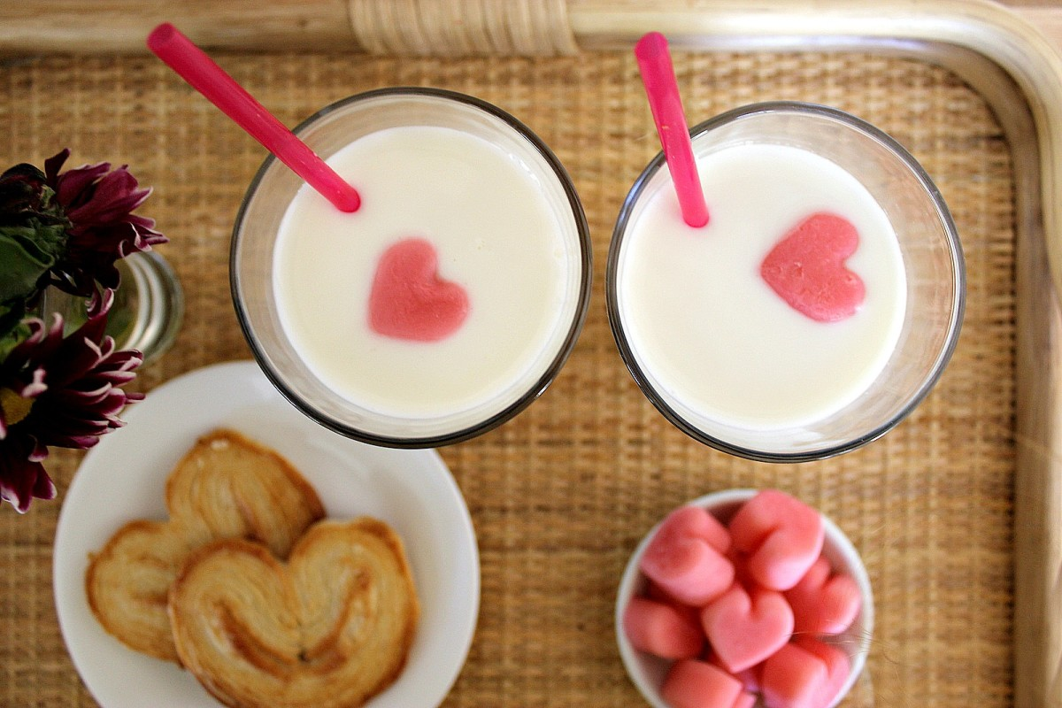 [http://blog.kidzui.com/2012/02/kids-valentines-day-snacks/kids-valentines-day-snacks - no longer active] Heart milk ice cubes as part of a kids' snack.