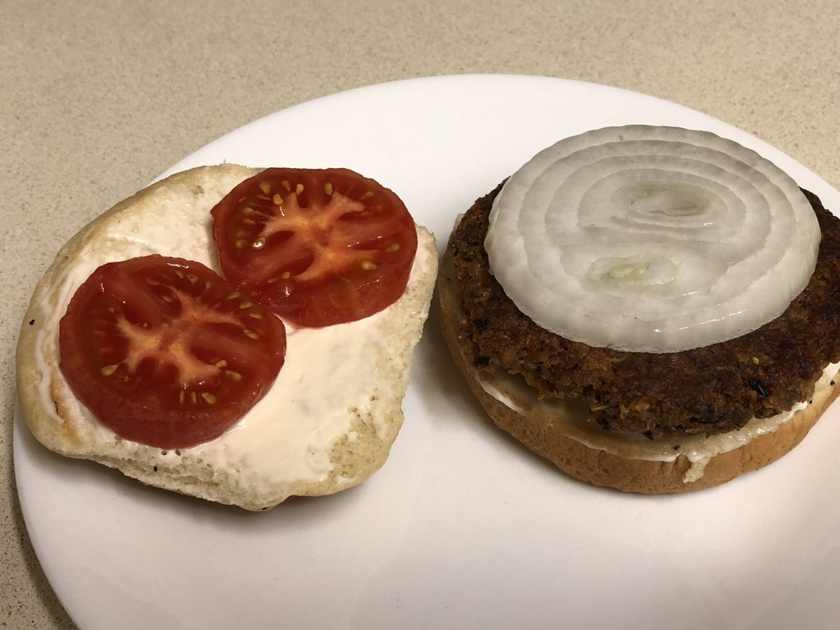 Veggie burger with tomatoes and onions.