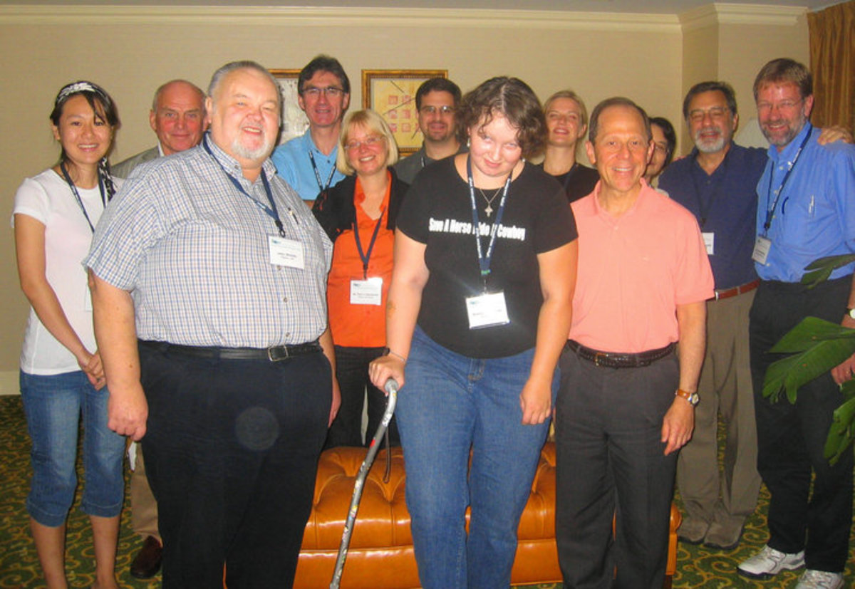 My dad and I with Dr. Kaplan, head researcher, and other laboratory scientists, at 2007 Symposium