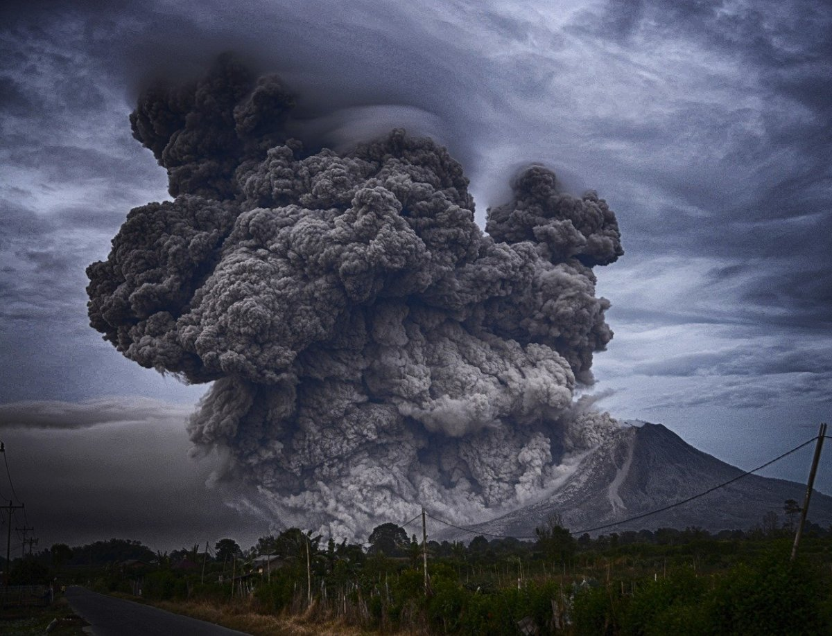 A large volcanic eruption which emits large amounts of ash and chemicals into the atmosphere.