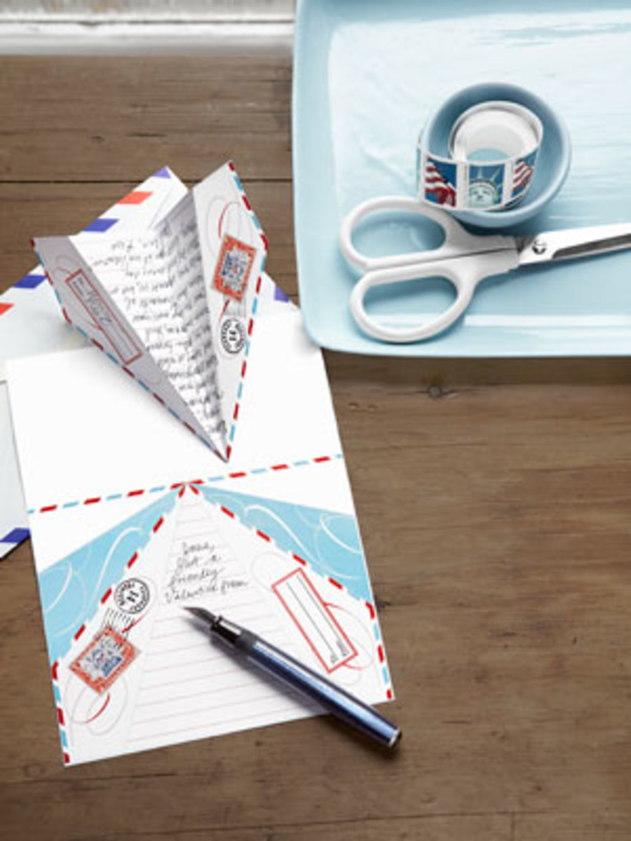 Send Your Love A Paper Airplane For Valentine's Day.  You Can Find The Free Printable Template At Country Living.  Just Click On The Picture.