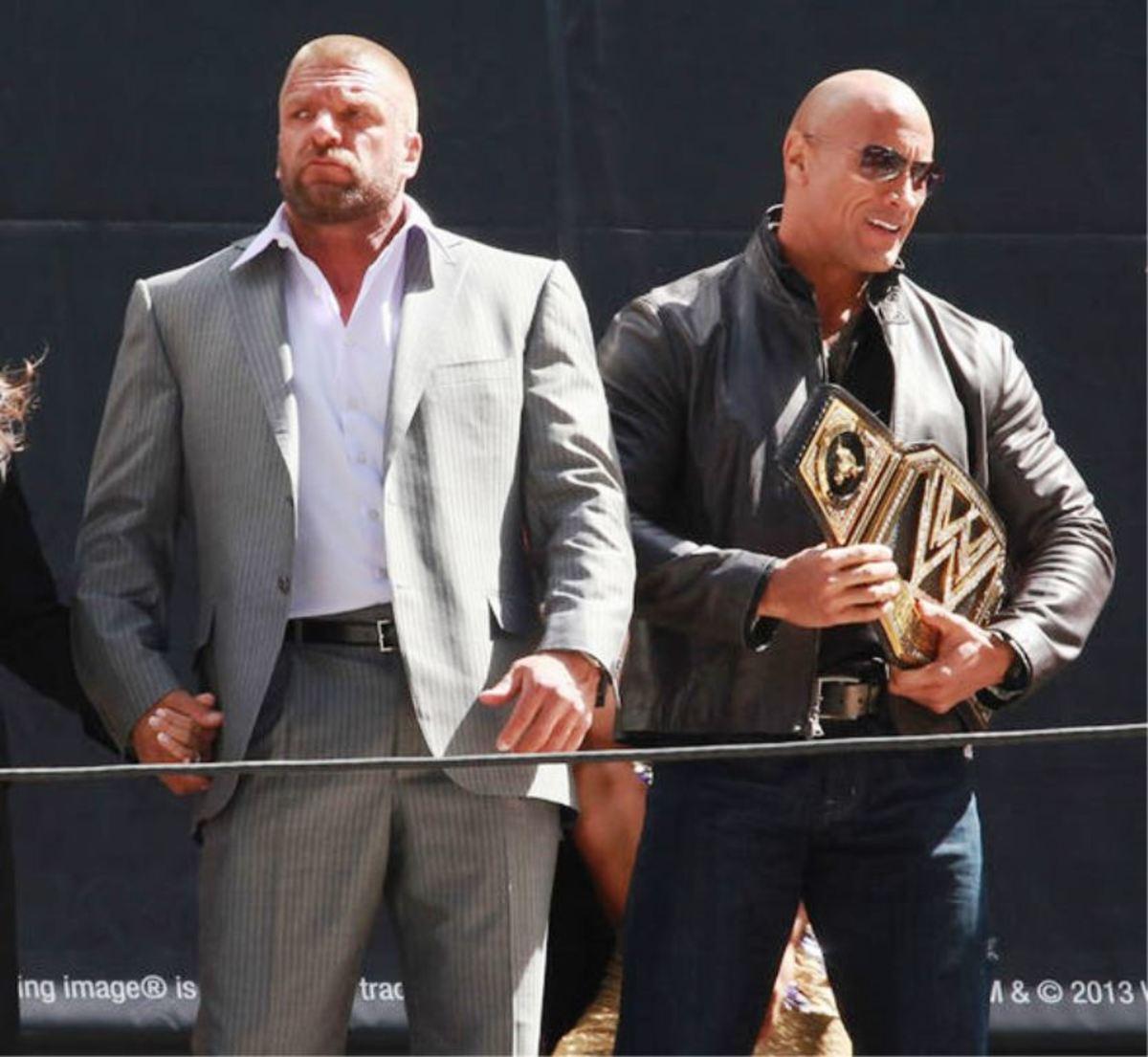 Triple H vs. The Rock.