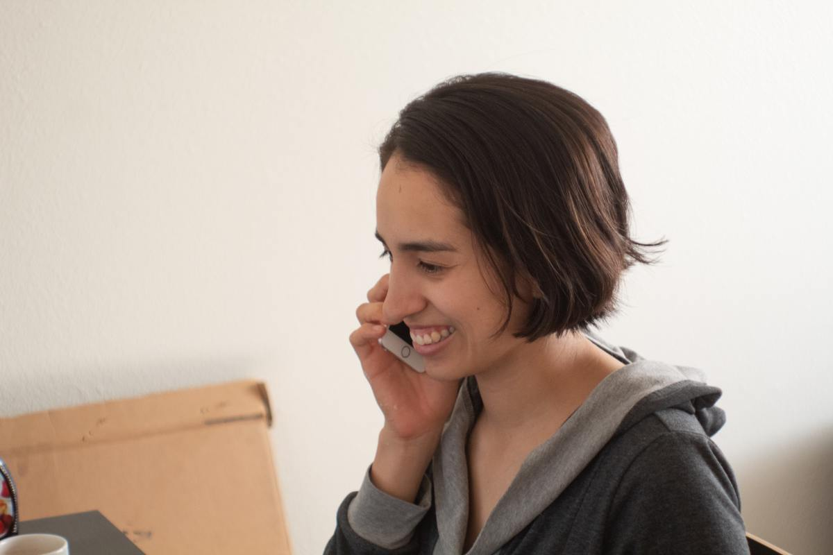 Woman talking to a mentor on the phone.