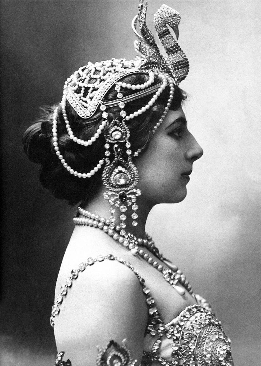In 1910 wearing a jeweled head-dress-