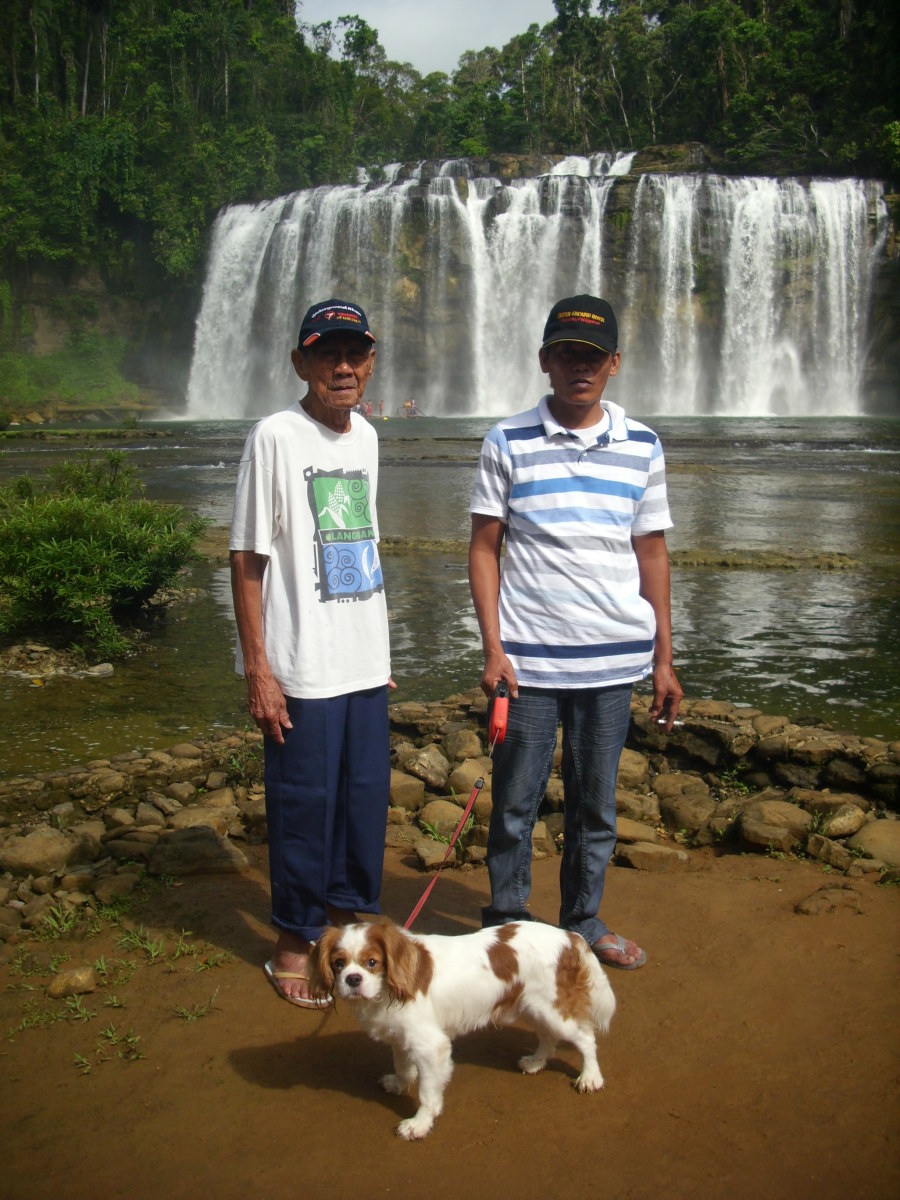 Is he not cute? Angus with my father and brother at Tinuy-an Falls