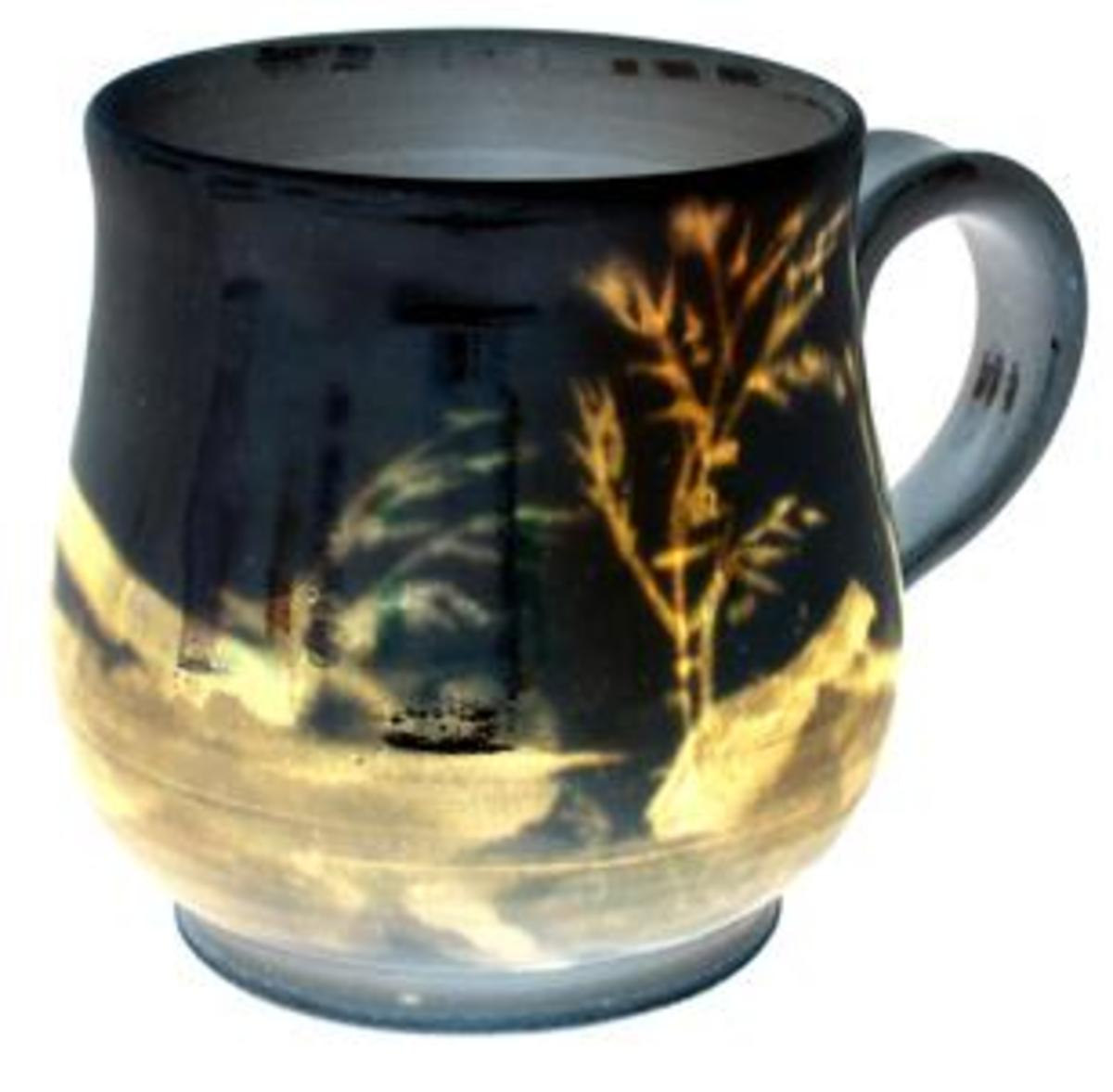 Glaze applied on Porcelain Cup - The glaze gives color and decorate the ware for a higher aesthetic value,strengthen the ware, as well as make the ware waterproof  unglazed earthenware will absorb water and bacteria can flourish in them